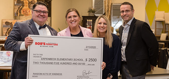 A Random Acts of Kindness check is presented to Erpenbeck Elementary School by Bob's employees